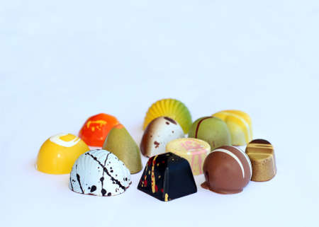 differently: Group of chocolate bonbons differently decorated
