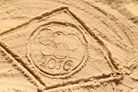 olympic symbol: PRAIA DA PIPA, NATAL, BRAZIL - AUGUST 18, 2015: Ilustrative editorial of Olympic rings drawn in the sand on a beach in anticipation of 2016 Summer Games in Rio de Jeneiro.
