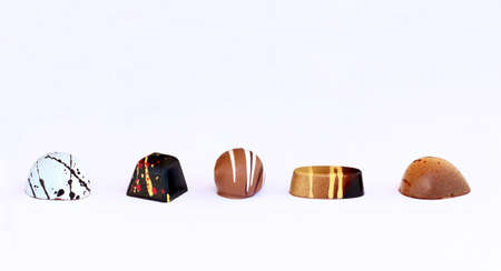 bonbons: Five chocolate bonbons different in shape and taste in line