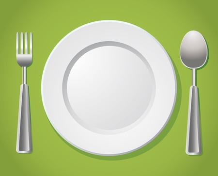 dinning table: white plate with silver spoon and fork