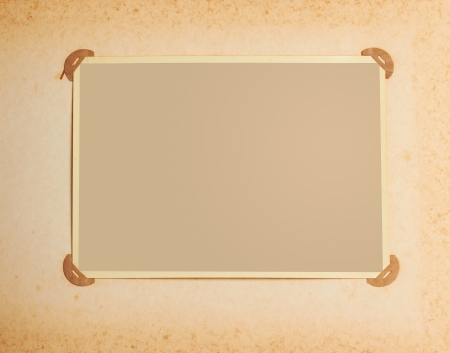 photo album page: old-fashioned photo frame in vintage album