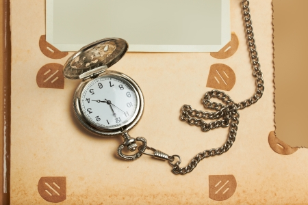 retro album page with vintage clock with chain Stock Photo - 14735681