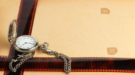 album page with vintage clock with chain and filmstrip photo