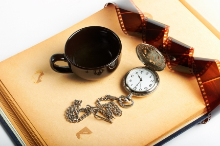 vintage clock with chain and filmstrip and coffee cup photo