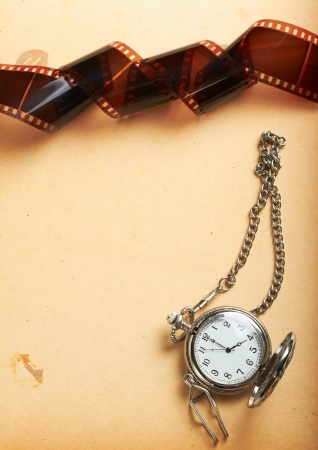 album page with vintage clock with chain and filmstrip Stock Photo - 14735690
