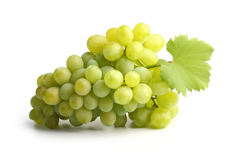 fresh white grapes with leaf on white