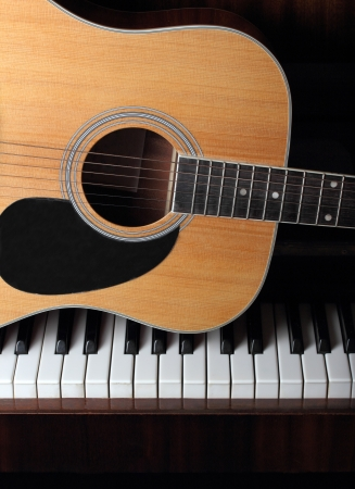 acoustic guitar on piano keys 스톡 콘텐츠