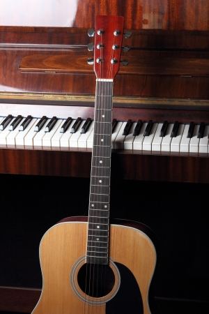 old piano: acoustic guitar on old piano keys