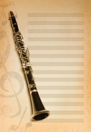 clarinete: fondo musical con la flauta, clave y notas