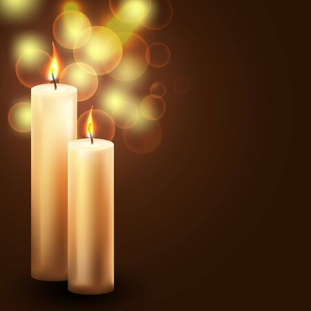 winterly: two candles on blurry holiday background