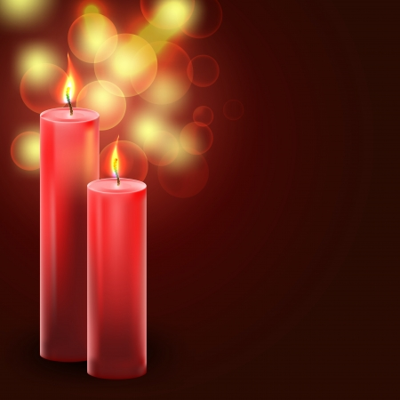 winterly: two red candles on blurry celebration background