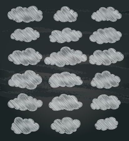 white clouds: set of cartoon white clouds on chalkboard. vector
