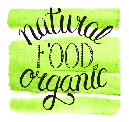 organic background: eat natural organic food hand lettering sign on watercolor background