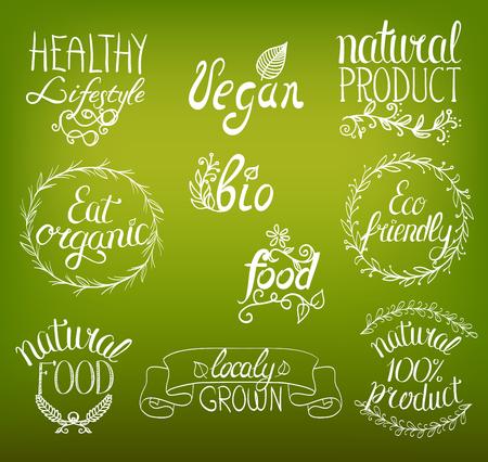 オーガニック、ビーガン、手書きサインの背景にリボン、花飾り、ビネットの自然食品。
