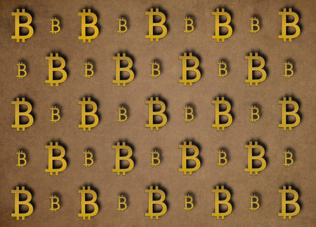 Texture of sign crypto currency of bitcoin on gold background. Symbol BTC. Bitcoin bifurcation Zdjęcie Seryjne