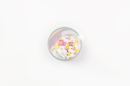 glass full of colorful medicines,pills, vitamins or supplements. The concept of addiction treatment