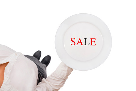 Plate with sale word in the waitress hand on the white background. Top view. Concept of discount and sales. Isolated Imagens