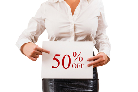 Female in the blouse holding white paper with inscription 50% OFF. Special Offer. Sales and discount concept. White background. Imagens