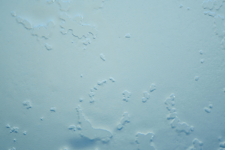 The texture of close up water of melted snowflake or frost on the glass. Winter background ant texture.