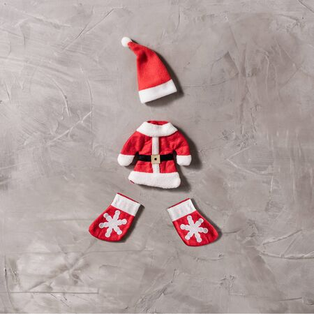 Funny santa claus costume on the concrete background. Cristmas Concept