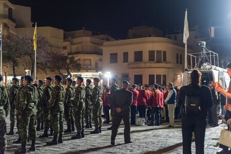 Heraklion, CRETE, GREECE - 28 APRIL 2019: Easter celebration night outside Agios Minas Cathedral. A marching band and military parade in the old town of Heraklion.