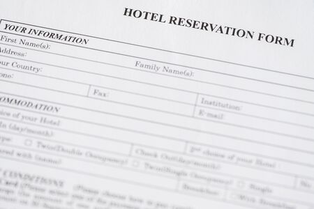 Hotel reservation form. Hotel service. Reception desk, registration. Close up. Selective focus. Standard-Bild