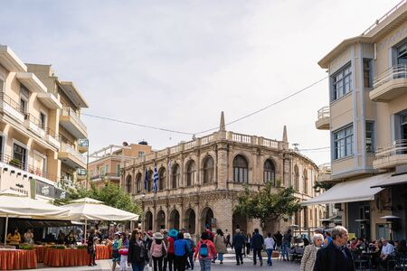 Local people, tourists walking on a famous Heraklion street in historical center. Shopping road. Crete. Greece. Stok Fotoğraf - 148182783