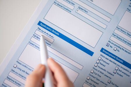 Woman filling contract, Applicant details. Close up. Selective focus. Standard-Bild