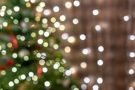 Blurred background of christmas tree with light and bokeh. Copy space