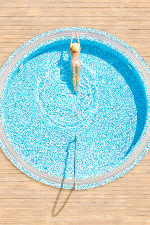Young alone beautiful sports woman in bikini and hat is swimming in . Aerial drone view from above. Vertical ratio, size 免版税图像