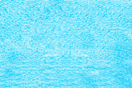 Blue transparent water surface in the swimming pool. Horizontal pool background. Aerial, drone view 免版税图像