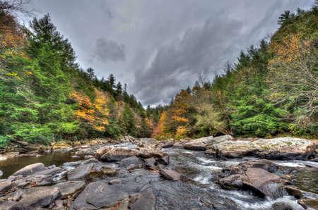 appalachian: A wild river in the Appalachian mountains during Autumn