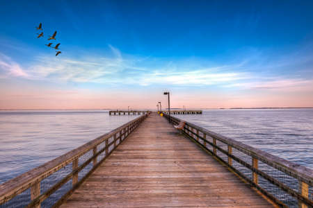 high dynamic range: High Dynamic Range image of a Fishing pier on the Eastern shore of the Chesapeake Bay in Maryland