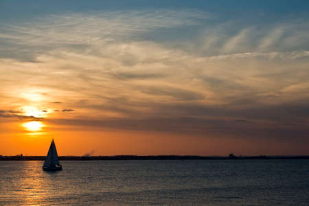 mariner: A sailboat on the Chesapeake bay in Maryland at sunset