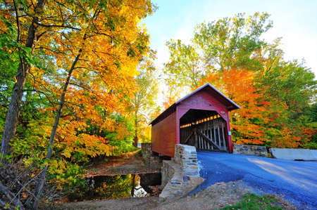 covered bridge: Loys Station Covered Bridge in Maryland during Autumn Stock Photo
