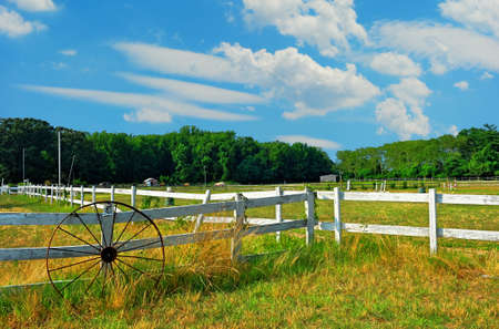 white fence: Horse stable in Maryland on a summer day Stock Photo