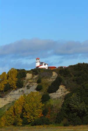 bluff: Lighthouse on bluff in Nikiski Alaska in Autumn