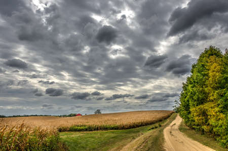 red barn: Country road in the rural western Maryland countryside with farmland and red barn