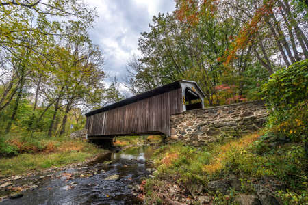 Rudolph and Arthur covered brige in Pennsylvania during Autumn