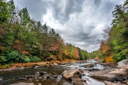 Swallow falls waterfall and river in the Appalachian mountains of Maryland during Autumn Stok Fotoğraf