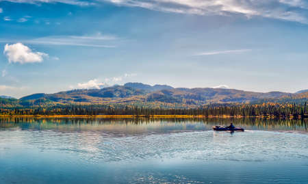 Kayaking on a lake in the mountains on the Kenai peninsula in Alaska during Autumn Stok Fotoğraf