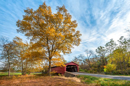 Old rustic bucolic covered bridge in the Maryland countryside during Autumn Stok Fotoğraf