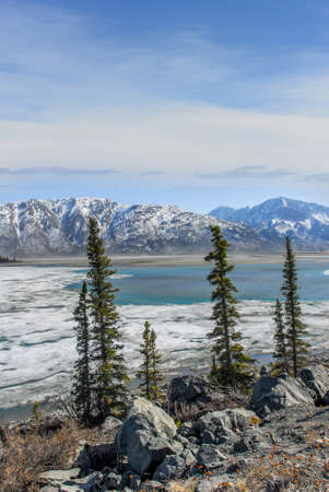 Landscape of a frozen lake thawing in the Spring in the Wrangell Mountains in Alaska