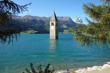 Bell tower of the former parish church of St. Katharina in Reschensee South Tyrol
