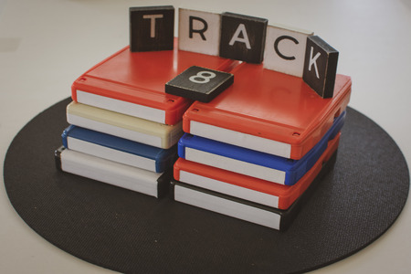 8 track tapes on black background with lettering