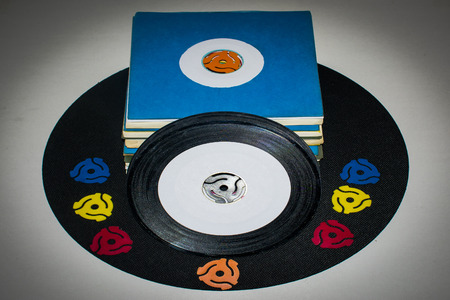 45 rpm retro records with adapters
