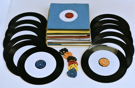 45 rpm records with adapter spindles