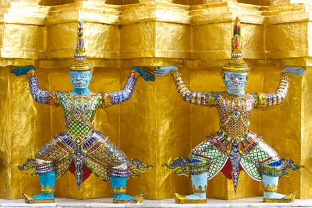 Antique Thai Giant sculptures around golden pagoda in the Emerald Buddha temple, Bangkok, Thailand photo