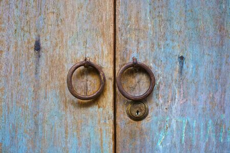 Old wood door with circle door knob photo