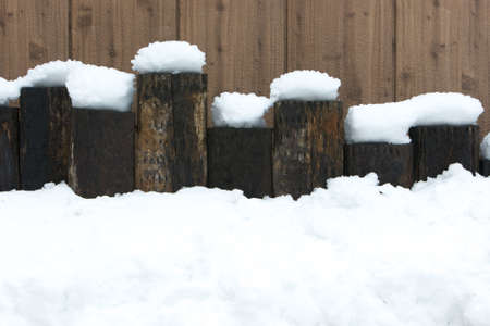 Lovely snow on wood Stock Photo